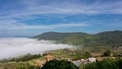 4K video time lapse : Fade out of fog at mountains park with blue sky Stock Footage
