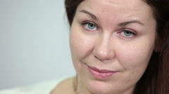 Face of Caucasian woman with green eyes and long brunette hair, close up - stock footage