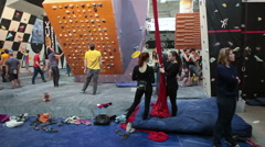 People climbing on championship, indoors Stock Footage