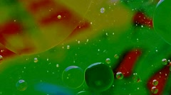 Oil drops floating in water Stock Footage