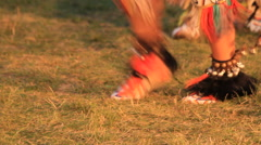 Many dancing moccasins and bells at a pow wow Stock Footage