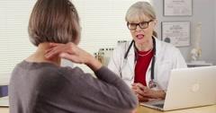 Senior woman doctor patient laptop computer Stock Footage