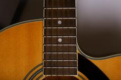 Acoustic guitar detail - stock photo