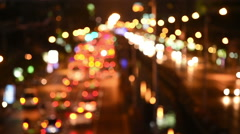 Blur light of the traffic light  at night on Sathon road,Thailand. Stock Footage