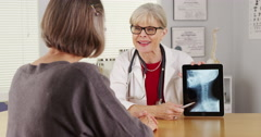 Senior doctor tablet talking x-ray Stock Footage