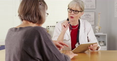Senior woman doctor tablet talking patient Stock Footage
