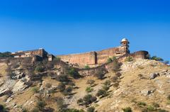 Ancient walls of Amber Fort with landscape in Jaipur - stock photo