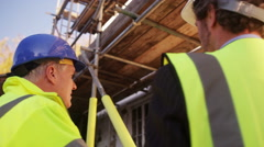 4K Engineers or architects conducting an inspection on construction site - stock footage