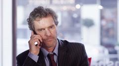 4K Depressed businessman hangs up someone during phone conversation - stock footage