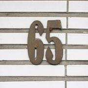 Metal house number sixty five -  65 Stock Photos