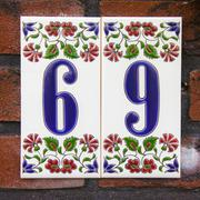 ceramic house number sixty inen on two separate tiles -  69 - stock photo