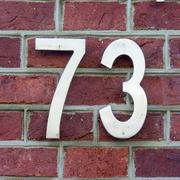 Metal house number seventy three. - 73 Stock Photos