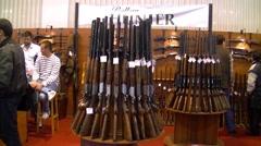 Huntion ng guns and rifles fishing and hunting  fair - stock footage