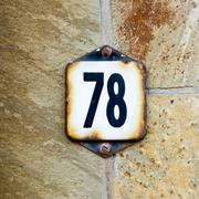 Enameled house number seventy eight - 78 Stock Photos