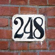 house number two hundred and forty eight. - 248 - stock photo