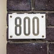 house number eight hundred. Black numerals on a white background - 800 - stock photo