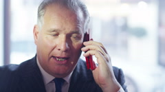 4K Serious businessman having a phone conversation on mobile phone - stock footage