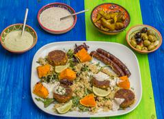 Quinoa with roasted pumpkin, falafel and sausages - stock photo