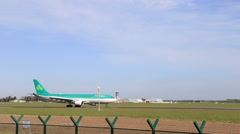 Aer Lingus aircraft taxiing on the runway to the gate Stock Footage