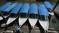 Row of Boats At Langkawi Geopark Boat Jetty, Pan Up - stock footage