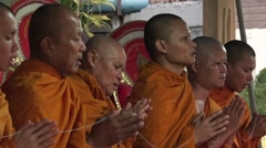 Monks pray together  in Thailand Stock Footage