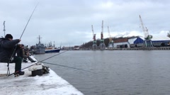 Fisherman Throws Fishing Tackles at Pier. Stock Footage