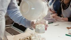 Sour cream is poured in a glass from a jug Stock Footage