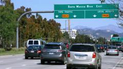 4K, UHD, Traffic on Santa Monica Boulevard and Hollywood sign,  Los Angeles Stock Footage