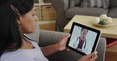 Senior black woman patient listening to doctor talk on tablet Stock Footage