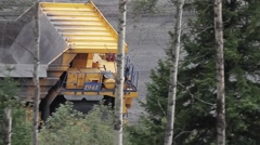Off-road dump truck moving on the road Stock Footage
