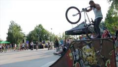 Bike Rider Jump On And Jump Of The Ramp In Skate Park, Bike Performance Stock Footage