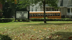 Sign Welcome Back Staff & Students outside school Stock Footage