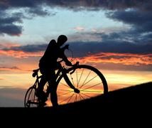 Silhouette of the cyclist Stock Photos
