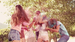 In slow motion happy friends covered in powder paint Stock Footage