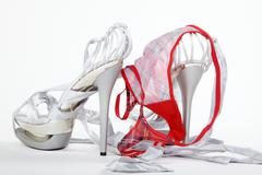 silver high heels with slip - stock photo
