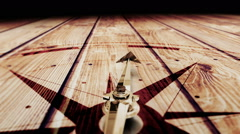 Compass pointing on wooden surface Stock Footage