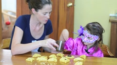 Jewish Mother and child preparing Hamantaschen cookie for Purim Jewish Holiday Stock Footage