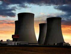Sunset over the nuclear power plant Stock Photos
