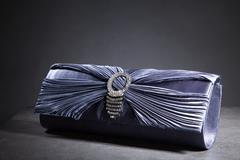clutch bag in an elegant design - stock photo