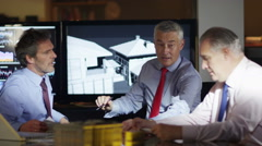 4K Group of engineers or architects discuss a building project - stock footage