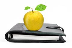 workbook with an Apple  - stock photo