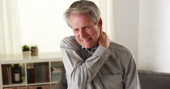 Elderly man with neck pain Stock Footage
