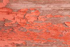 Authentic Wooden Wall with Peeling Off Red Paint Stock Photos