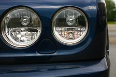 Headlights luxury of blue car Kuvituskuvat