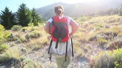 Woman backpacker walking by Limay river, North Patagonia Stock Footage