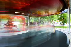 Roundabout rotating in children's park Stock Photos