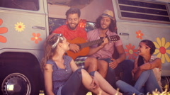 In high quality format hipster friends sitting by their camper van Stock Footage