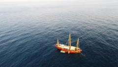 Chinese Junk ship boat in ocean aerial Stock Footage