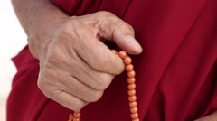 Buddhist Monk with Prayer Beads.mp4 Stock Footage