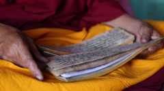 Buddhist Monk Reading a Prayer Book Closeup.mp4 Stock Footage